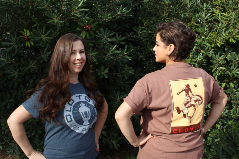 An image of two women wearing Clovis shirts