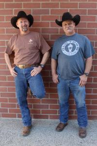 An image of two men wearing Clovis shirts