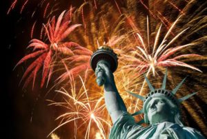 Celebration scene with fireworks and the statue of liberty