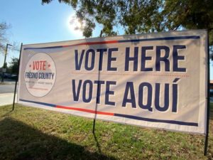 photo shows sign outside city hall which reads Vote Here