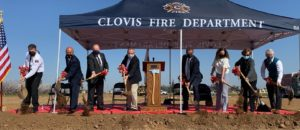 groundbreaking ceremony for Station 6, shows 8 individuals shoveling dirt.