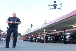 Officer operating a drone in the clovis police department parking lot